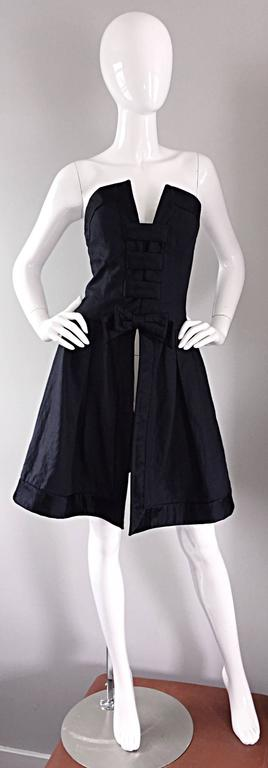 Chic vintage RENA LANGE black silk ' Avant Garde ' bow overdress! Dramatic bust line, with black silk bow adorned at waist. Cut-outs at back. Looks amazing on! Great with over simple black dress, or perfect with slacks. This is truly an AMAZING