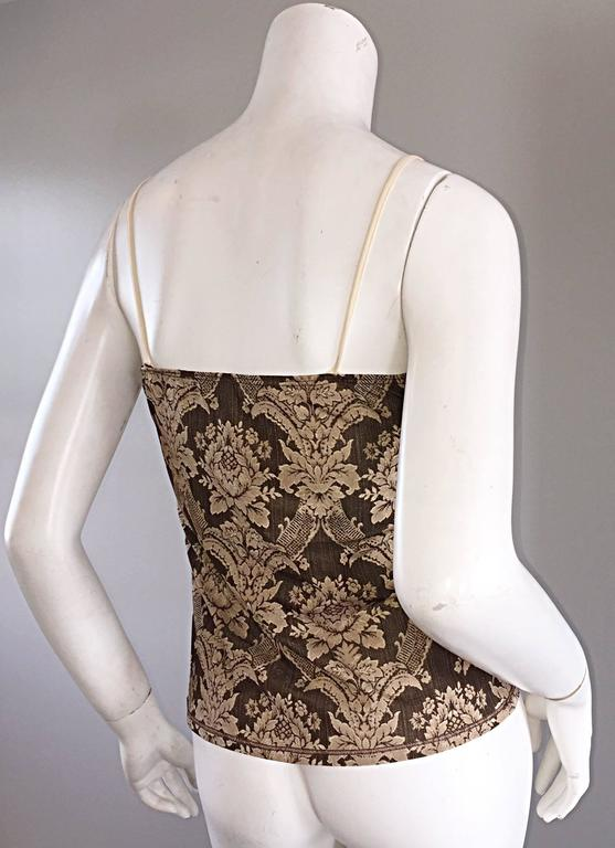 Amazing 1990s / 90s ROBERTO CAVALLI silk chiffon set! Features camisole, with lace bust, that peaks out of the wrap around blouse. Ruffles along the neck, and sleeve cuffs (which make chic bell sleeves. Regal print, that resembles Victorian lace.