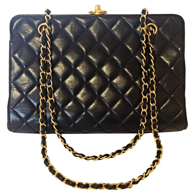 Vintage CHANEL black leather chain shoulder bag with golden CC kiss lock closure