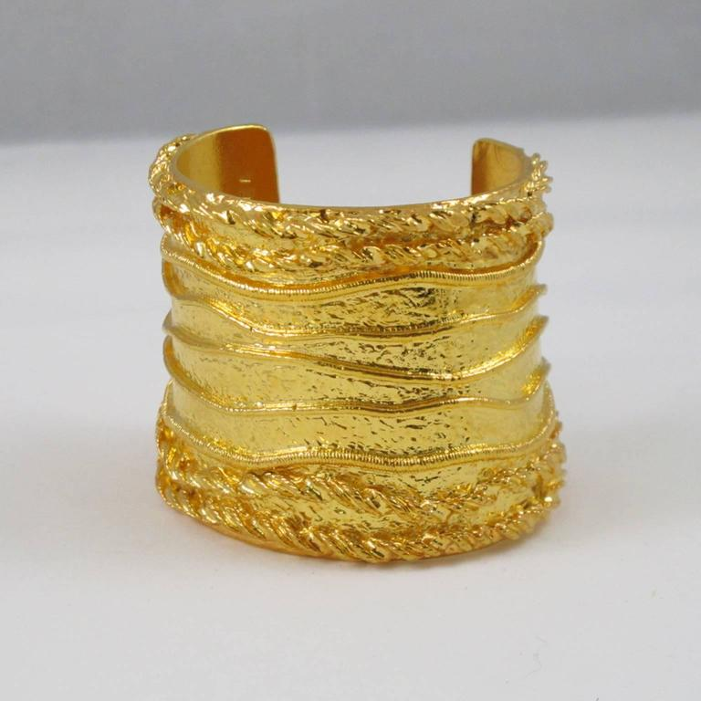 "SONIA RYKIEL Paris signed Cuff Bracelet. Massive baroque slave shape with gilt metal all textured and carved. Signed by famous French Jewel and Fashion Designer Sonia Rykiel: ""Inscription Rykiel"" engraved inside. (The label"