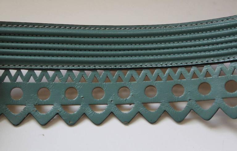 Teal scalloped leather laser cut belt from Azzedine Alaia dating to spring/summer of 1992. Size 75. Made in France. Very good condition.
