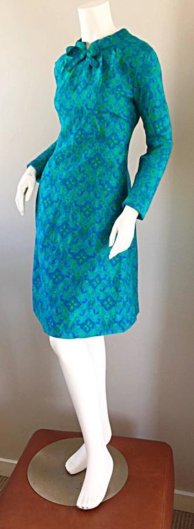 Charming vintage YEN YEN OF MALAYA 1960S teal blue and lime green paisley and brocade print silk A-Line dress! I have had the pleasure of owning a handful of dresses by this sought after 60s label, and this one is nothing less than perfect! Amazing