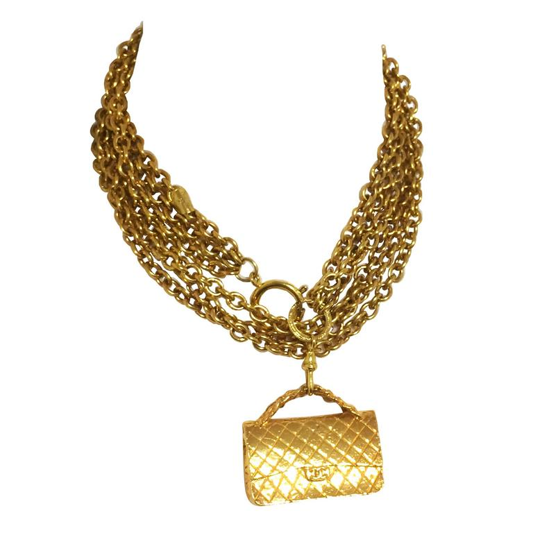 Vintage CHANEL golden double chain long necklace with classic 2.55 bag charm. For Sale