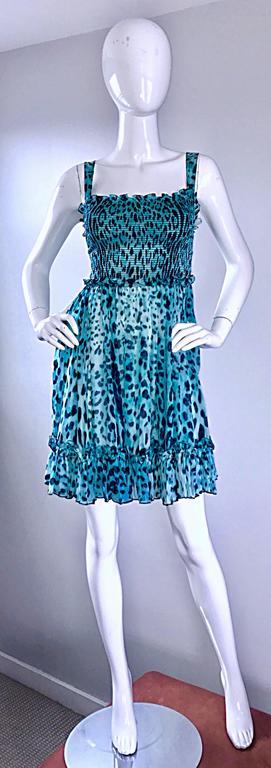Brand new GIAMBATTISTA VALLI vibrant blue silk chiffon Babydoll dress! Features an allover blue and black cheetah print. Ruffle details at hem, bust, and waist. Stretch to fit bodice is very flattering. Flirty full skirt. Softest silk chiffon feels