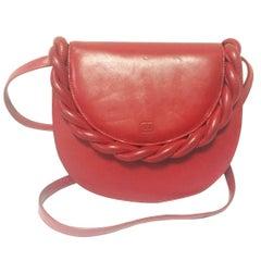 Vintage Valentino Garavani deep cherry red leather shoulder bag with twist motif