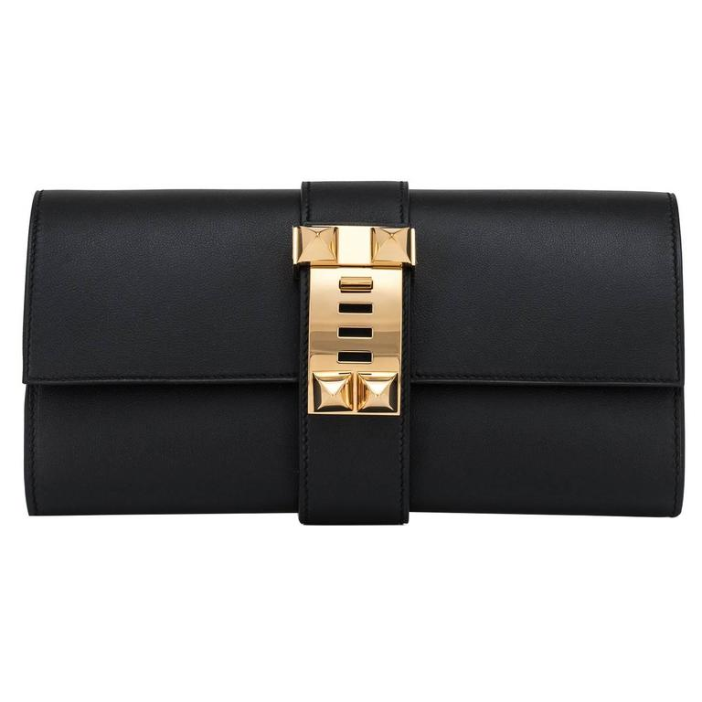 Hermes Black Medor Clutch Swift Leather Gold Hardware Elegant For Sale