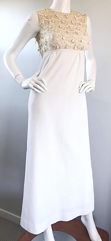 Gorgeous vintage 60s JACKY BRYAN ivory and white full length dress. Features a hand crochet lace bodice, which is adorned with hundreds of dangling white beads on the front and back. Chic full length white skirt. Full metal zipper up th eback with