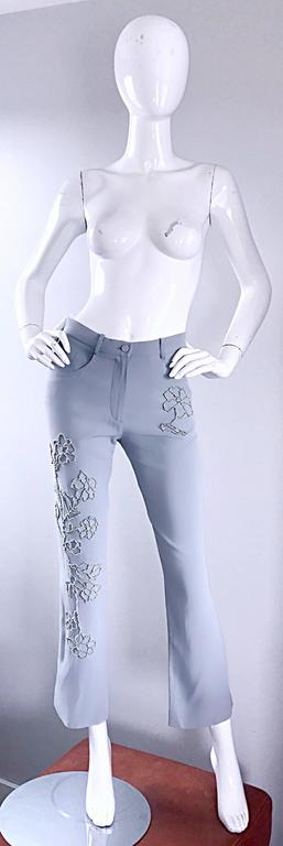 Beautiful and rare vintage 90s SONIA RYKIEL light blue beaded high waisted slim fit trousers! Silver beads in shapes of flowers throughout. Two pockets on the rear, and two at each side of the waist. Soft rayon crepe stretches to fit.  Button at