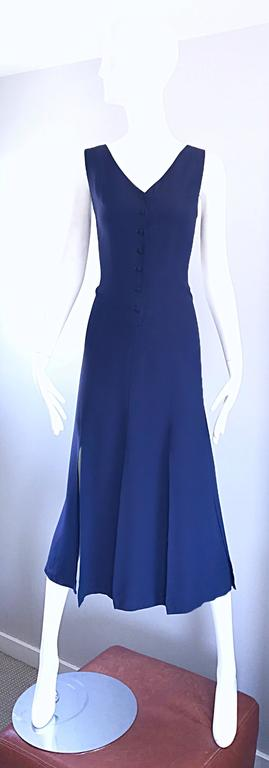 Rare and exceptional vintage GEOFFREY BEENE navy blue rayon car wash hem dress! Fitted bodice features functional black buttons up the front, which leads to a free flowing skirt with split panels. Looks amazing when worn, especially on the dance