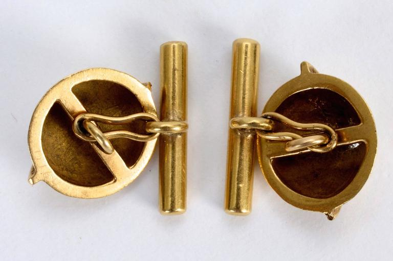 14 karat gold Art Deco cufflinks in the shape of the planet Saturn.   The Art Deco period often used celestial themes like stars and planets into their 'modern' designs.
