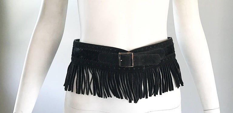 Rare, and so chic vintage YSL black leather suede + calf / pony hair wide fringed belt! Features black perforated suede trim, with a center calfhair in the middle. The fringe is cut from the actual belt, not sewn on. Impeccable quality with so much