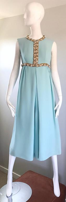 Amazing vintage 60s light blue silk crepe cropped culotte wide leg palazzo jumpsuit / onesie! Features hundreds of hand-sewn rhinestones, sequins and beads along the bodice. Tailored fitted bodice, with chic and forgiving wide legs. Hidden metal