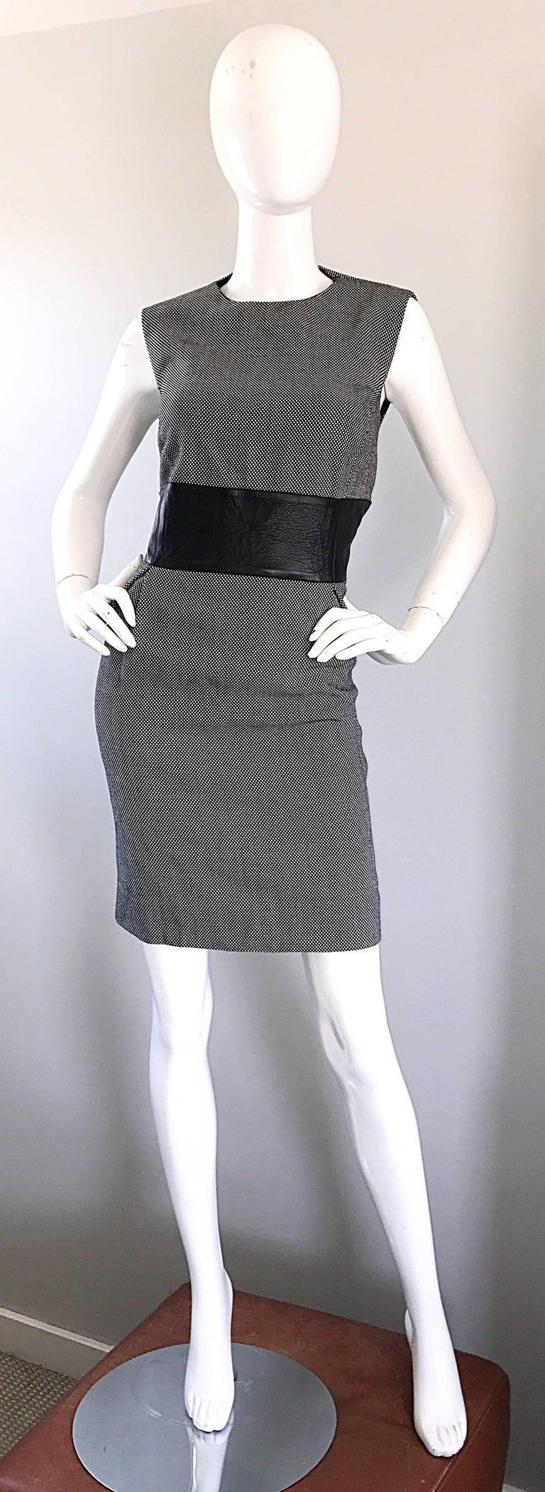Brand new MICHAEL KORS COLLECTION black and white virgin wool and leather dress! Classic style that is very figure flattering. Soft lightweight black and white wool body, with a flattering wide blackl leather band across the front and back waist.