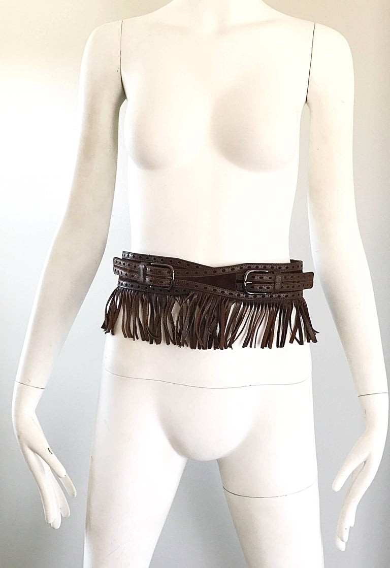 Rare chic 1970s YVES SAINT LAURENT black leather and suede fringe boho belt! Features brown leather and suede with leather fringe. Double buckle closure will fit an array of sizes. Great with jeans, shorts, a skirt or a dress.  In great condition.