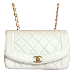 Vintage Chanel classic 2.55 white color lamb leather shoulder bag with gold CC.