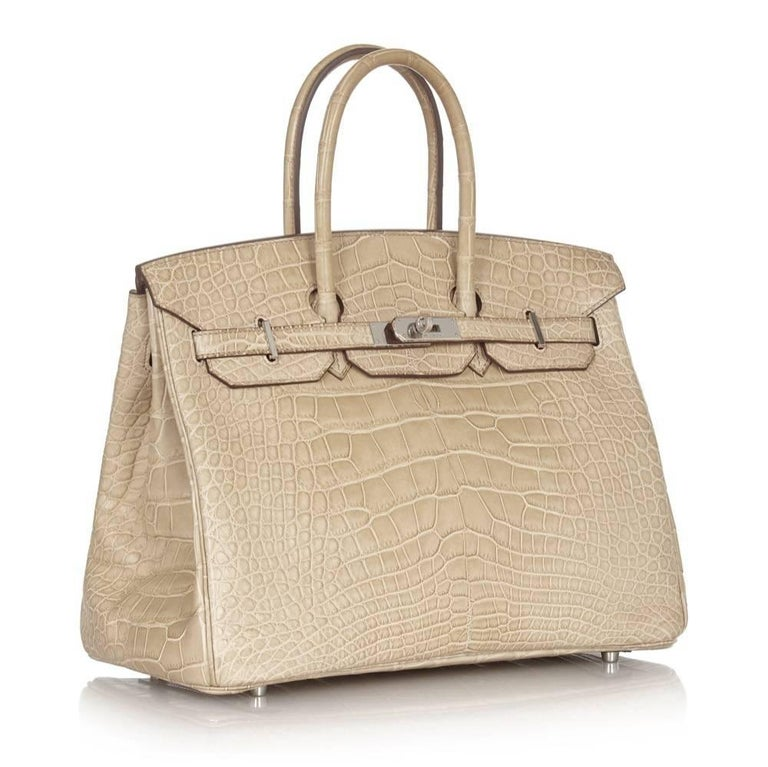 Crafted in matte Poussiere beige Porosus alligator leather and offset by cool-toned palladium hardware, this Hermès Birkin is a strikingly elegant statement piece. Porosus alligator is often lauded as the most precious of Hermès' exotic skins,