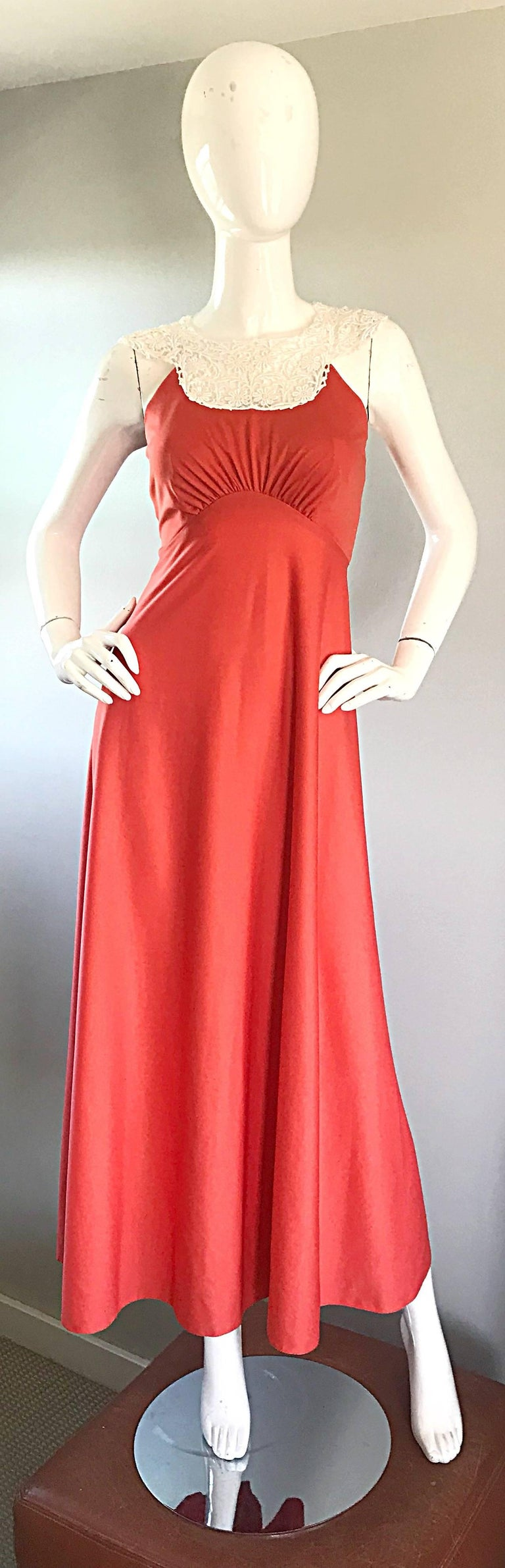 Striking coral / salmon pink jersey maxi dress! Hard to find color that compliments nearly any skin tone! Slinky jersey looks fantastic when on. White crochet lace collar makes for a stark contrast. Hidden zipper up the back with hook-and-eye