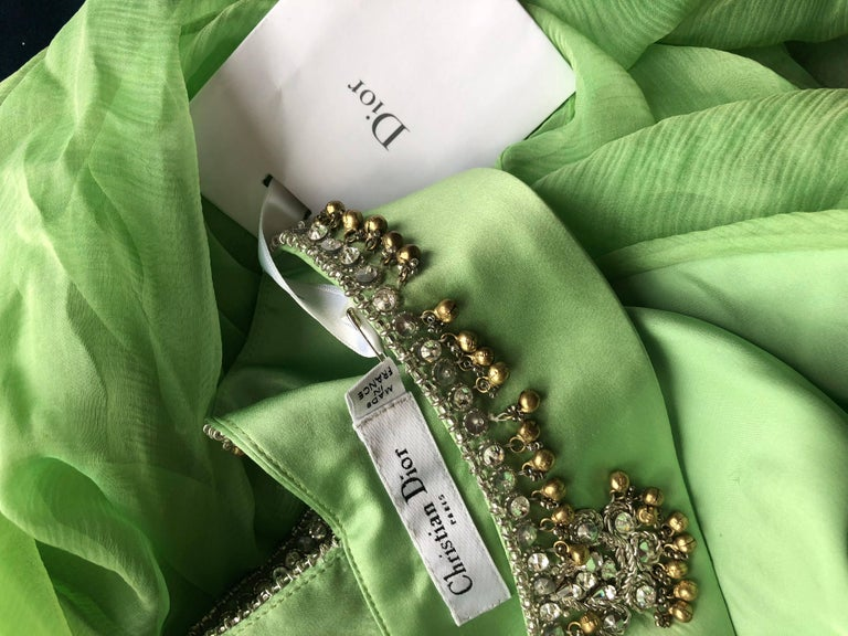 Absolutely breathtaking CHRISTIAN DIOR by JOHN GALLIANO new with tags light mint green silk chiffon beaded full length evening dress! Features the most luxurious silk chiffon draped over a light green silk satin. Beads, rhinestones, and pearls
