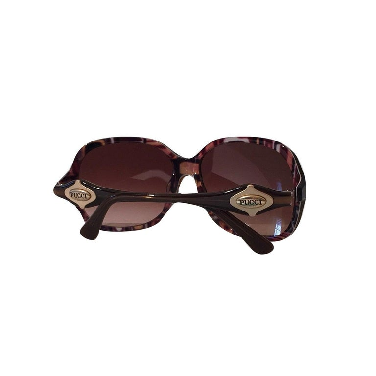 Emilio Pucci Sunglasses Brand New * Stunning Classic Pucci Sunglasses * Classic Brown Frames * Pucci Print Interior: * Browns, Creams, Pinks & Yellow * Gold Pucci Logo on Both Sides * Handmade ZYL in Italy * 100% UV Protection * Comes with Case,