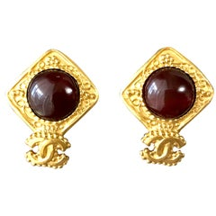 Vintage CHANEL golden square frame and wine red round gripoix stone earrings.