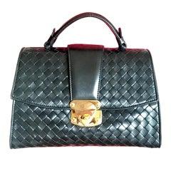 Bottega Veneta Vintage black lamb leather intrecciato handbag with golden hock.