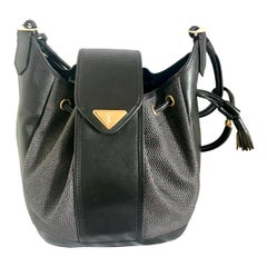 Yves Saint Laurent Vintage black hobo bucket shoulder bag with golden YSL motif