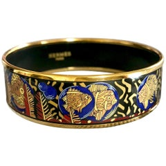 Vintage Hermes cloisonne enamel yellow fish in blue, black, red bangle bracele.
