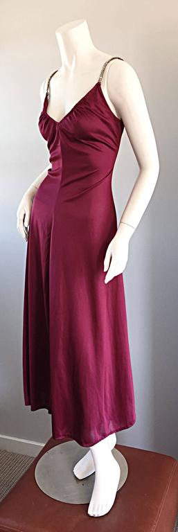 Sexy 1970s Joseph Magnin disco dress!!!! Rich burgundy wine color, with rhinestones encrusted on straps. Ruched bodice, that is so flattering on! Slinky skirt,with slit up the side. Looks great alone, or belted. Perfect with sandals, wedges, boots,