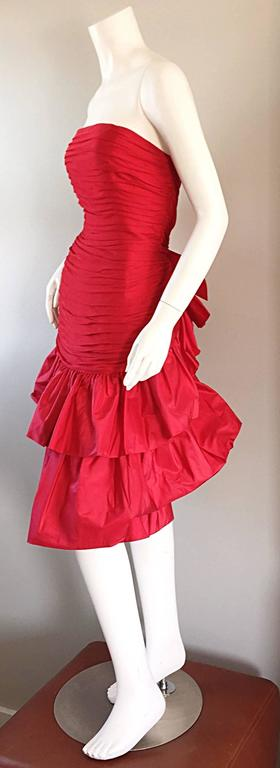 Amazing JILL RICHARDS, for SAKs Fifth Avenue, red silk + taffeta dress!!! Avant Garde feel, with tiered skirt, and bow in the back. Tulle layers over the silk bodice. Pouf skirt, with a bit of a drop waist. Couture quality, with hand finished work.