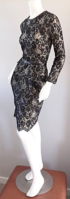 What a stunning Narcisco Rodriguez black and nude lace long sleeve dress! Black silk over nude silk. Leather trimmed at the sleeve cuffs, waist, and collar. This beauty also features PCOKETS at both sides of the waist. Pleating detail at waist that
