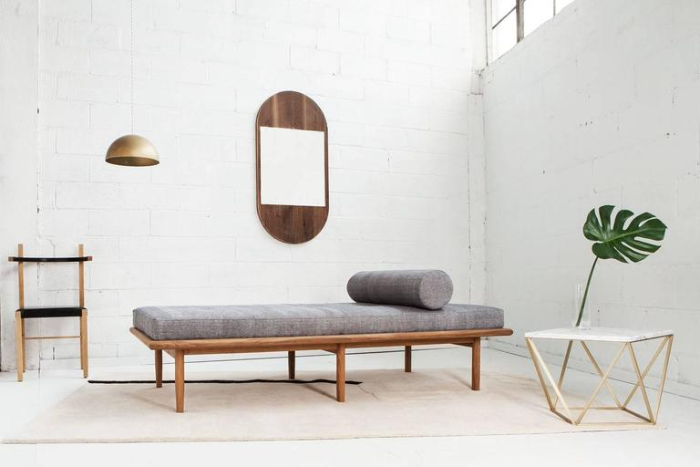 Designed by Coil + Drift  Scandinavian minimalism and calm, luxurious texture come together in this six-legged modern daybed. The white-oak base is comprised of a rounded-edge frame and distinctively hand- shaped legs, which taper on two sides. The