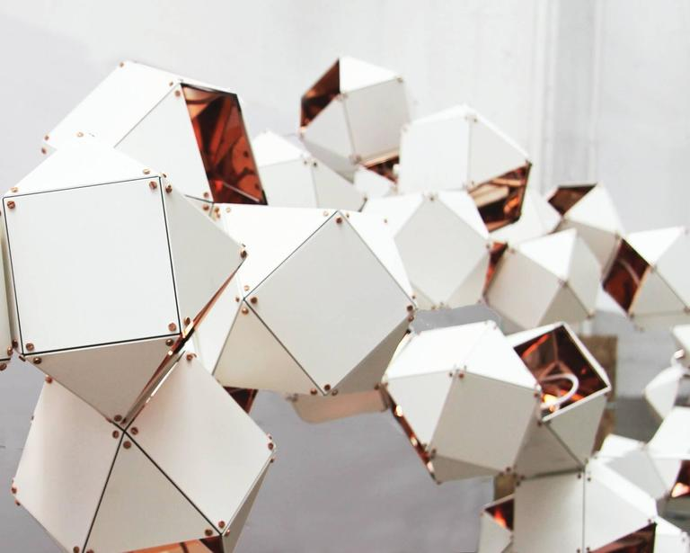 Made up of a sequence of interconnected geometric shapes, the Wellesis a modular and customizable lighting-system that forms sculptural and organic shapes in all its various configurations and silhouettes.  From long branches to large clusters, the