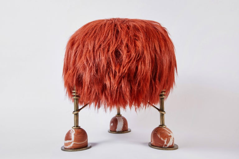 With an inherent spirit of a wild child, Rebelle is a petite sitting stool with a soulful style all her own. Featuring cinnabar-dyed natural long goat hair, sandcast burnished brass legs and 'Sang de Poulet' marble feet, Rebelle is a perfectly sized