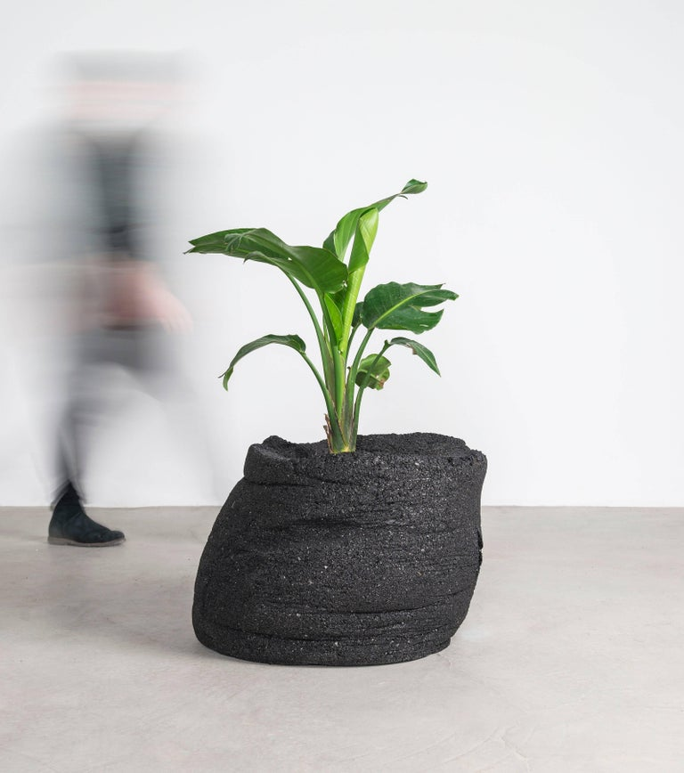 The design for Fernando Mastrangelo and actor Boyd Holbrook's Coal Planters was based upon the conceptual process by which they were made. Mastrangelo and Holbrook adapted the physical labor involved in mining, using shovels and heavy-duty machinery