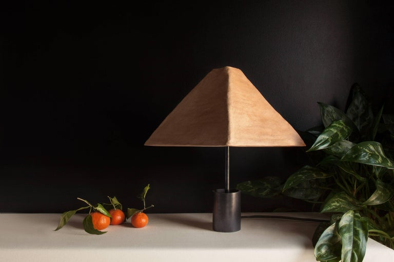 Each of the stoneware shades is handmade in the Foothills of the Appalachian Mountains in South Eastern Ohio. The grogged and toothed clay bodies are hand-pressed onto molds making each one-of-a-kind. The pyramid shade references traditional linen