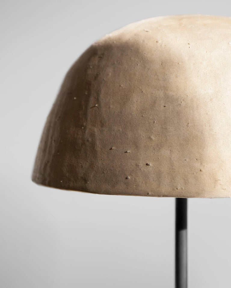 Each of the stoneware shades is handmade in the foothills of the Appalachian Mountains in South Eastern Ohio. The grogged and toothed clay bodies are hand-pressed onto molds making each one-of-a-kind. The Dome Table lamp is a organic interpretation