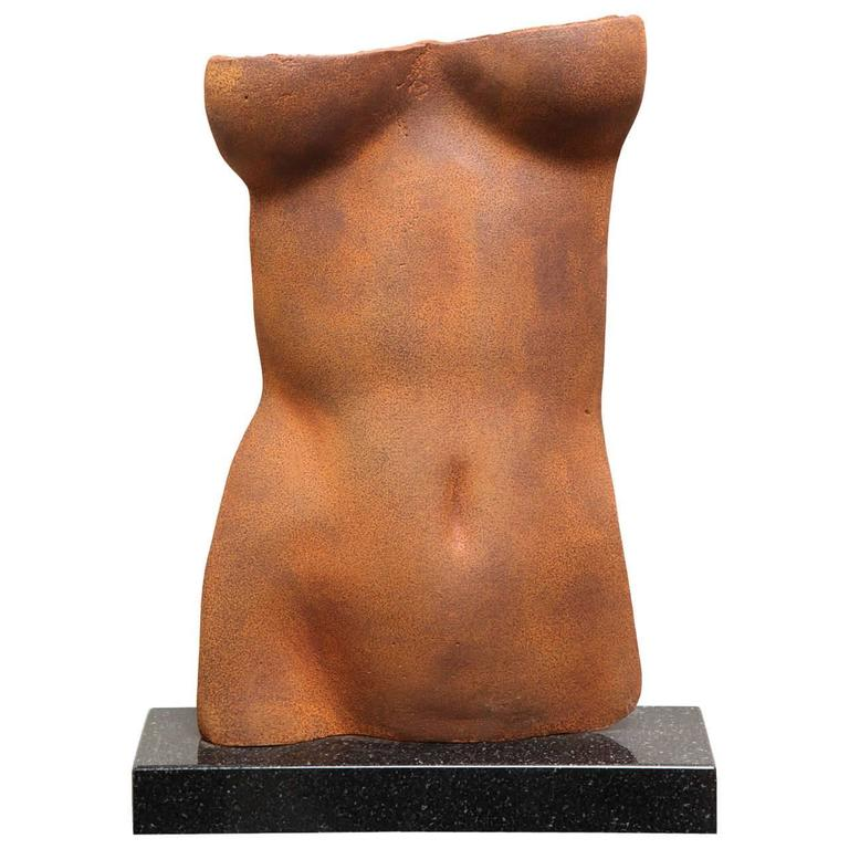 """Torso is a classic motif today and  in the Hellenistic Time. This Cast Iron Torso on Granite Base is edition 9 of 10. The sculpture is the perfect """"Gods of Small Things"""". Rare and unique."""