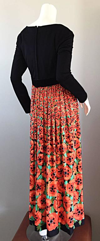 Beautiful vintage Joseph Magnin maxi dress! Jet black bodice, with 3-D 'hibiscus' printed maxi skirt. Hibiscus flowers start out small at waist, ending in oversized printed flowers at bottom. Chic long bow at waist, with hook-and-eye closure at back