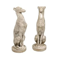 Pair of Vintage Carved Cement Greyhound Sculptures Sitting on Circular Bases