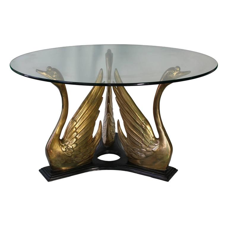 Hollywood Regency Style Glass Top Coffee Table With Brass Swan Trio Base At 1stdibs