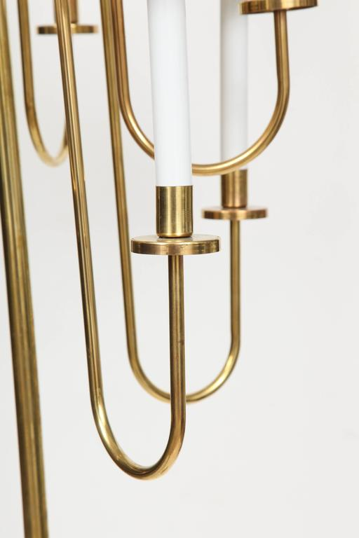 """Hollywood Regency candelabra style brass floor lamp composed of eight graceful arms on a solid heavy brass base. Rewired for use in the USA. Height to top of finial is 72"""", to top of arms is 63"""".  Shades not included."""