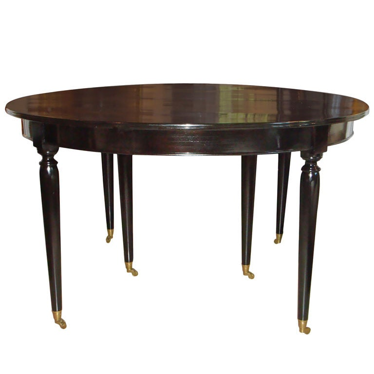 black ebonized dining table with 2 leaves at 1stdibs
