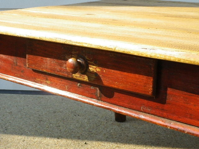 English Pine Coffee table with turned legs and original old red paint to base. One drawer, waxed pine top.