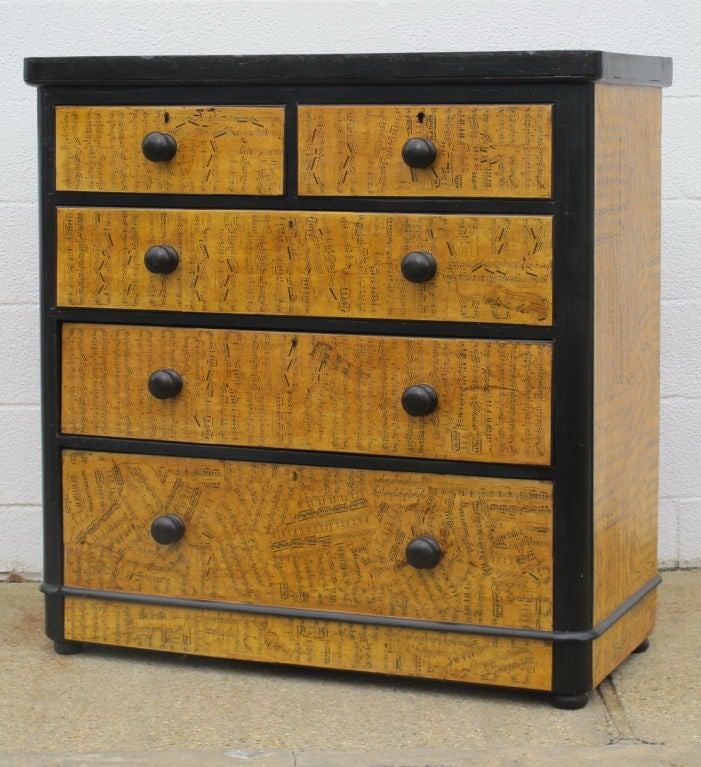 A 1930's pine chest of drawers with later applied music sheets in decoupage