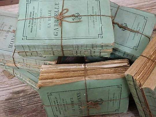 bundles of 3 19th C French paperback books, for decoration. Sold in sets of 3 books. Wonderful pale green color. $ 150 per bundle