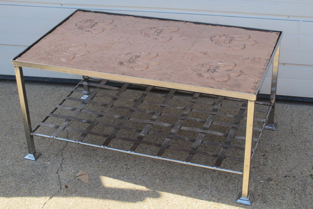 Antique Copper Panels on re-constructed polished iron base frame with metal strap shelf.