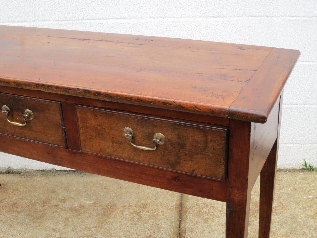 An Elm Server with 3 drawers, tapered legs.