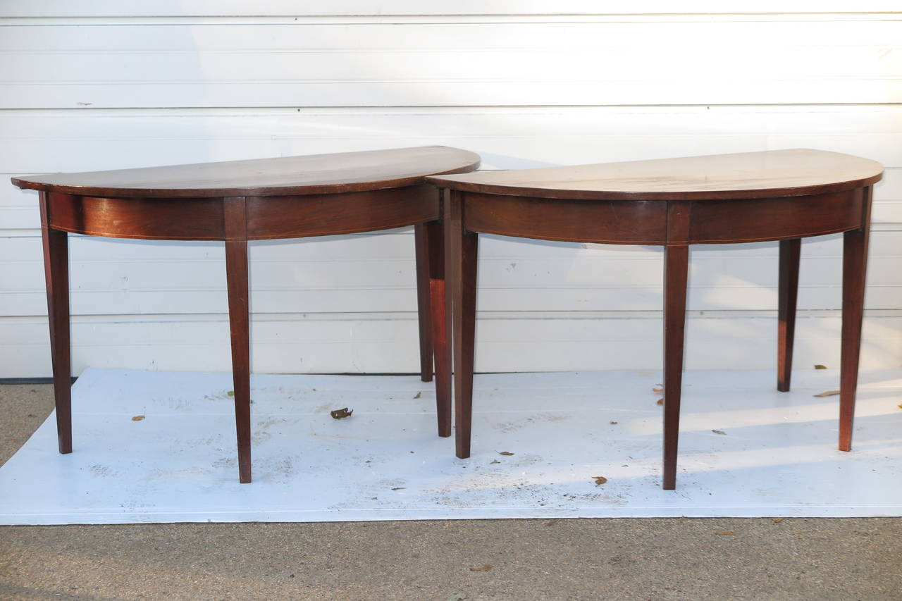 Pair of demilune tables. Please contact for current availability.