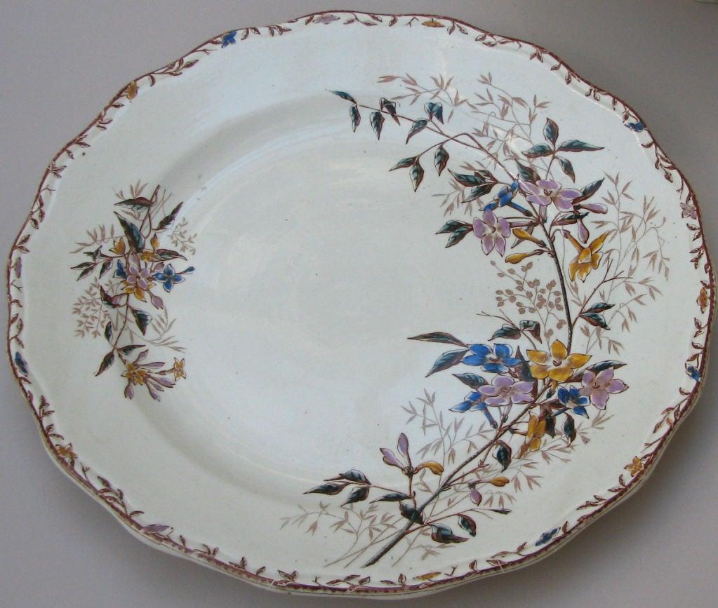 "A late 19th century iron stone part dinner service. Sarreguemines. Jasmin pattern. Marked. France, circa 1895.  Measures: 12 dinner plates 9.625"" diameter; one platter 13.125"" diameter; one tureen 12.125"" diameter."