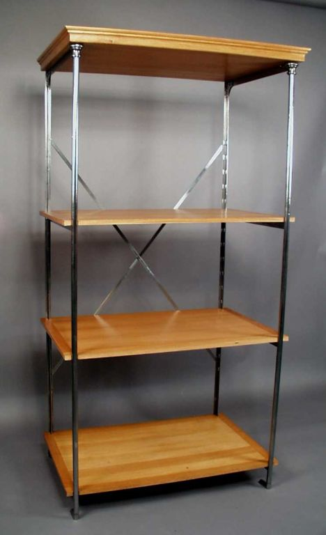 An antique polished steel etagere having three (later) oak shelves, circa 1900, France.